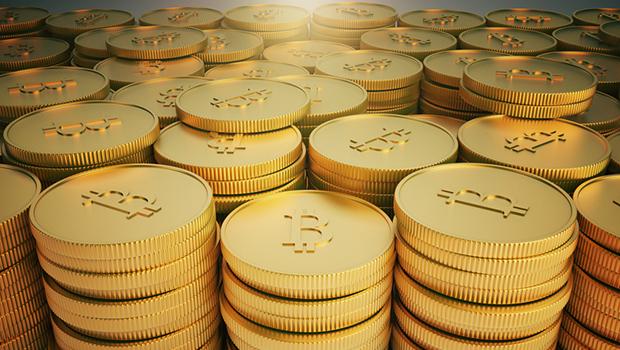 Group of golden Bitcoin coins, 3d rendering