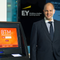 大手Ernst & Youngが来年からビットコイン払いを受領へ